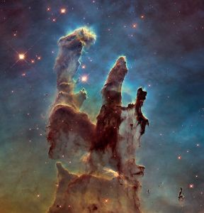 A high-resolution picture of the Pillars of Creation, in the Eagle Nebula, 7,000-light-years from Earth, via the Hubble Telescope, circa 1995, retouched January 5, 2014. (Armbrust via Wikipedia via NASA). In public domain.