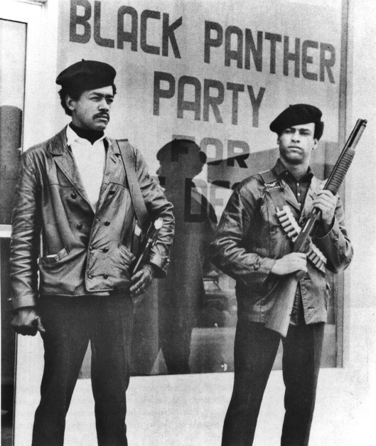 Black Panther national chairman Bobby Seale, wearing a Colt .45 and defense minister Huey Newton with a bandolier and shotgun, poster, Oakland, CA, 1968. (AP via http://pbs.org).