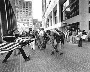 The Soiling of Old Glory, Boston, MA, April 5, 1976. (Stanley Forman/Boston Herald American via Wikipedia). Qualifies as fair use due to historical important of photo and low resolution.