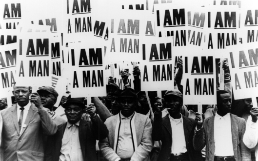 Striking members of Memphis Local 1733 hold signs whose slogan symbolized the sanitation workers' 1968 campaign, March 1968. (Richard L. Copley/http://dlxs.lib.wayne.edu/).