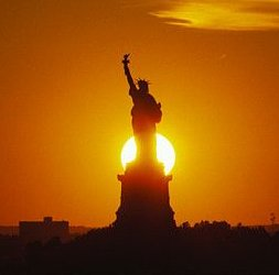 The Sun setting behind the Statue of Liberty, New York, July 4, 2003. (http://science.nasa.gov/).