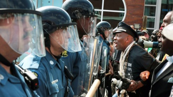 Militarized St. Louis County Police and protesters standoff, Ferguson, MO, September 10, 2014. (Robert Cohen, St. Louis Post-Dispatch/AP via http://motherjones.com).