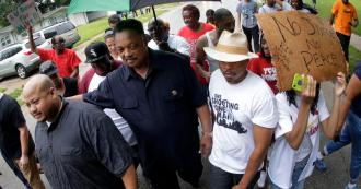 Rev. Jesse Jackson with group of protesters, Ferguson, MO, August 15, 2014. (http://www.cbsnews.com).