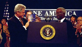 John Hope Franklin (1915-2009) handing President Bill Clinton the One America Report, ending role in Initiative on Race, White House, September 18, 1998. (http://clinton4.nara.gov via Wikipedia). In public domain.