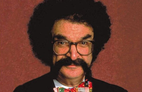 Film critic Gene Shalit (closest approximation I could find to David Wolf), circa 1980. (http://imdb.com).
