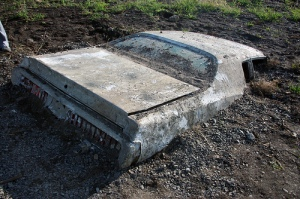 A partially buried car on Governor's Island, NY, September 13, 2009. (http://scoutingny.com).
